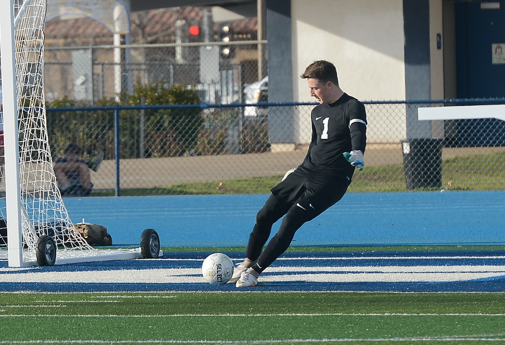 . Pleasant Valley High\'s Austin Mathews (1) kicks the ball, Thursday, March 8, 2018, in Chico, California. (Carin Dorghalli -- Enterprise-Record)