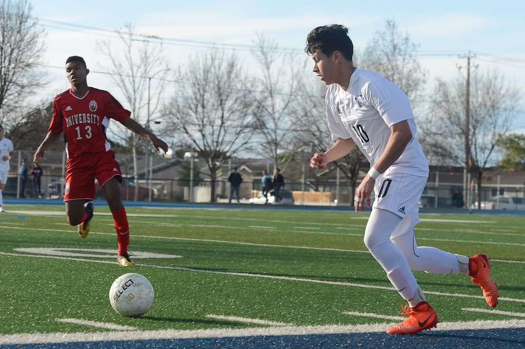 . Pleasant Valley High\'s Ari Reyes (10) gets ready to kick the ball away from University High\'s Zeke Ume-Ukeje (13), Thursday, March 8, 2018, in Chico, California. (Carin Dorghalli -- Enterprise-Record)