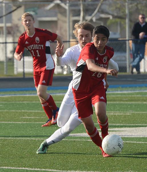 Pleasant Valley High's Logan Hall (21) chases University High's Carlos Jaramillo (26), Thursday, March 8, 2018, in Chico, California. (Carin Dorghalli -- Enterprise-Record)