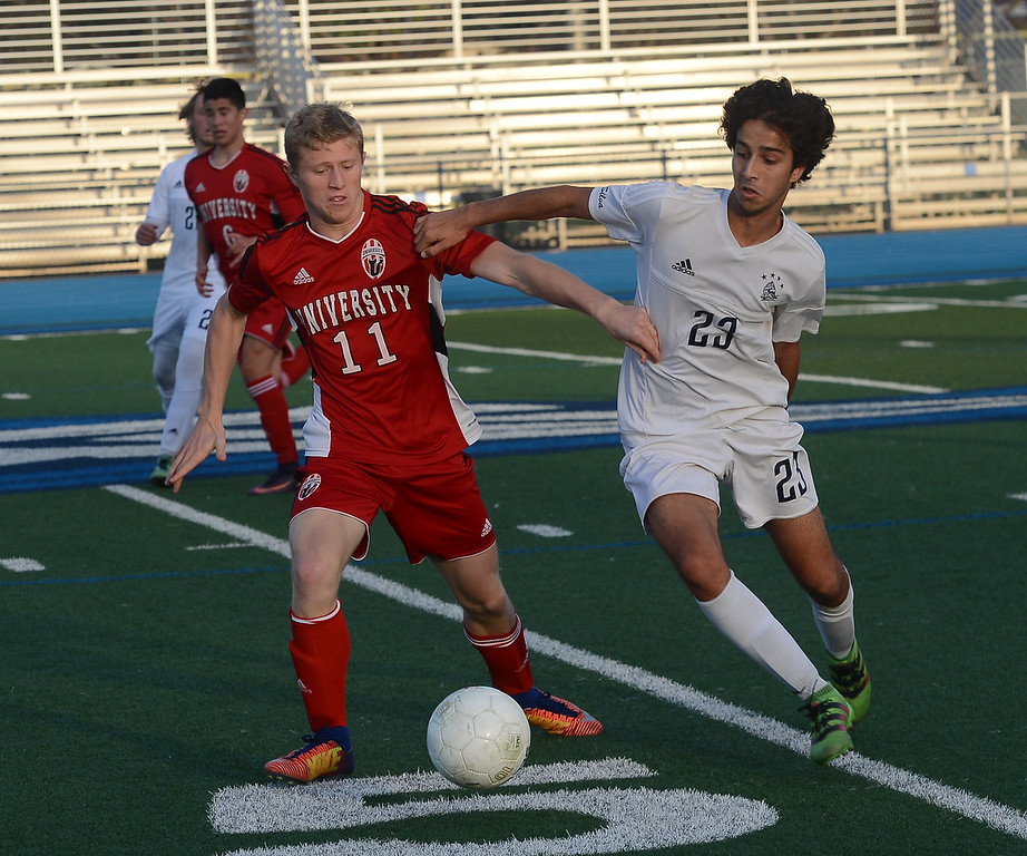 . Pleasant Valley High\'s Tomas Oliveras (23) and University High\'s Elliott Britton (11) fight for the ball, Thursday, March 8, 2018, in Chico, California. (Carin Dorghalli -- Enterprise-Record)
