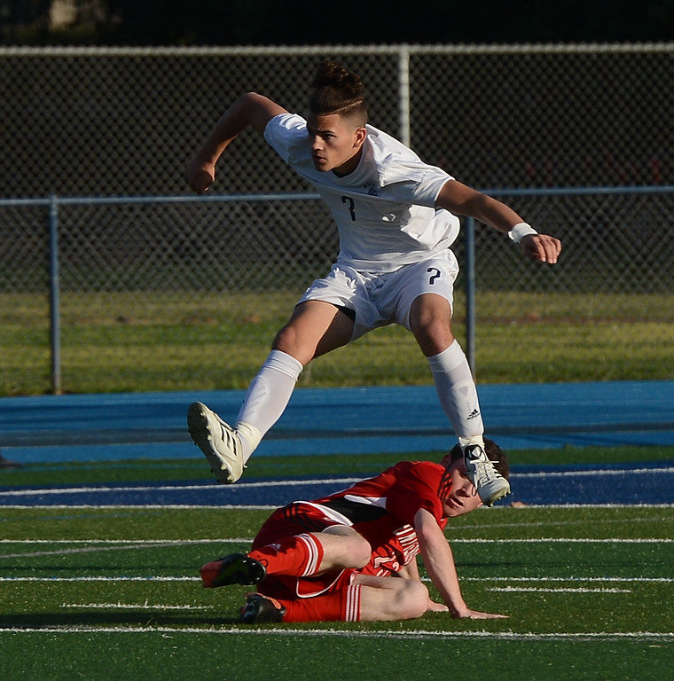 . Pleasant Valley High\'s Akira Ramirez (7) jumps over a University High player, Thursday, March 8, 2018, in Chico, California. (Carin Dorghalli -- Enterprise-Record)