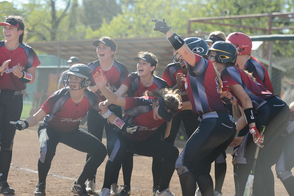 . Chico High excitedly meets Nina Pennisi at the home plate after she makes a homerun, April 19, 2018, in Chico, California. (Carin Dorghalli -- Enterprise-Record)