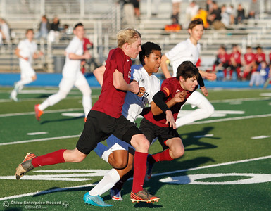 Pleasant Valley's Dante Jackson (14) pushes his way through West Valley's Gideon Ferrier (left) and James Uboldi as the Vikings work to defeats West Valley 6-1 in Northern Section Division 1 semifinal soccer match, sending the Vikings to the championship game against Chico High this Saturday Thursday February 23, 2017 at Pleasant Valley High School in Chico, California. (Emily Bertolino -- Enterprise-Record)