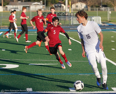 With West Valley's defense closing in Pleasant Valley's Kyle Johnson (16) looks to pass during the Northern Section Division 1 semifinal soccer match, sending the Vikings to the championship game against Chico High this Saturday Thursday February 23, 2017 at Pleasant Valley High School in Chico, California. (Emily Bertolino -- Enterprise-Record)