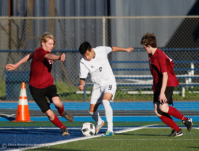 Pleasant Valley's Daniel Rodriguez (9) uses his quick feet to move past West Valley's Gideon Ferrier (21) helping the Vikings defeats West Valley 6-1 in Northern Section Division 1 semifinal soccer match Thursday February 23, 2017 at Pleasant Valley High School in Chico, California. (Emily Bertolino -- Enterprise-Record)