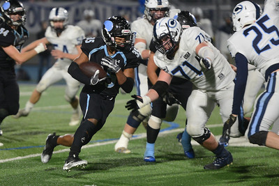 Pleasant Valley's Anthony Ioane runs past Central Valley Christian's Dirk Nelson in the CIF State Championship game, Dec. 8, 2018, in Chico. (Carin Dorghalli -- Enterprise-Record)
