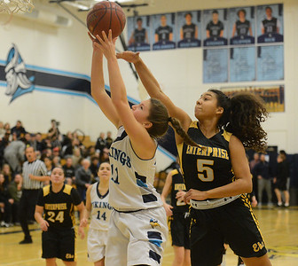 Enterprise High's Jaydyn Matthews (5) reaches over Pleasant Valley's Olivia Layne to stop the shot  Friday January 12, 2018 in Chico, California. (Emily Bertolino -- Enterprise-Record)