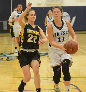 Pleasant Valley's Olivia Layne (11) looks to shoot as Enterprise High's Caroline Forseth (20) tries to stop her Friday January 12, 2018 in Chico, California. (Emily Bertolino -- Enterprise-Record)