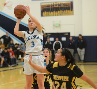 Pleasant Valley's Claire Garcia (3) goes up for a shot over Enterprise High's Mary Phan Friday January 12, 2018 in Chico, California. (Emily Bertolino -- Enterprise-Record)