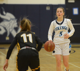 Pleasant Valley's Chloe Mayer (5) sets the play as Enterprise High's Karina Archibald (11) waits on defense Friday January 12, 2018 in Chico, California. (Emily Bertolino -- Enterprise-Record)