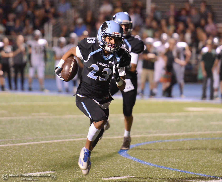 . Pleasant Valley\'s Quiane Rhodes runs downfield to score the second tough down of the night against Paradise High School football October 6, 2017 in Chico, California. (Emily Bertolino -- Enterprise-Record)