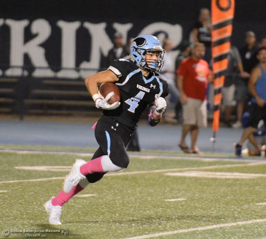. Pleasant Valley\'s Caleb Cooley runs with the kickoff return to score the first touchdown of the night against Paradise High School October 6, 2017 in Chico, California. (Emily Bertolino -- Enterprise-Record)