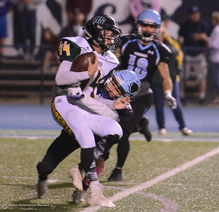 Pleasant Valley's Dalton Walker drags down Paradise High's Ethan Hughes during a football game October 6, 2017 in Chico, California. (Emily Bertolino -- Enterprise-Record)