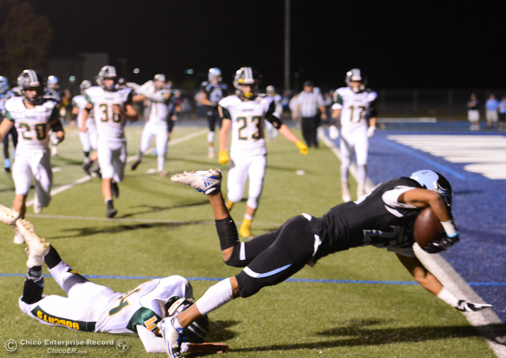 . Pleasant Valley\'s Quiane Rhodes dives into the end zone  for the second touchdown of the night against Paradise High October 6, 2017 in Chico, California. (Emily Bertolino -- Enterprise-Record)
