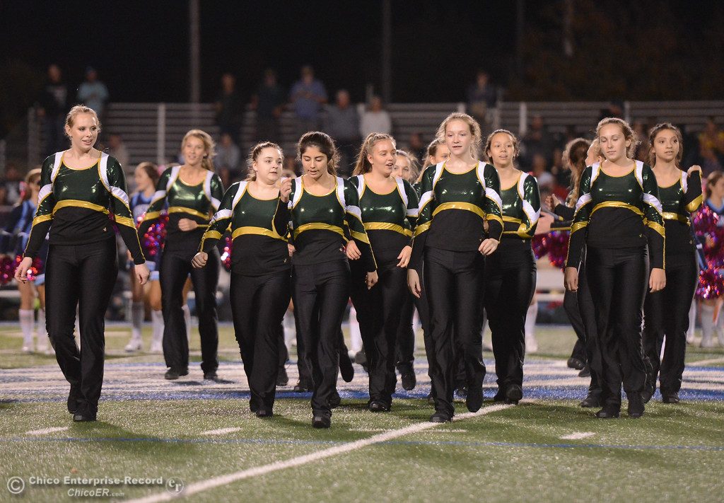 . Paradise High cheerleaders take the stage during a halftime game against Pleasant Valley October 6, 2017 in Chico, California. (Emily Bertolino -- Enterprise-Record)
