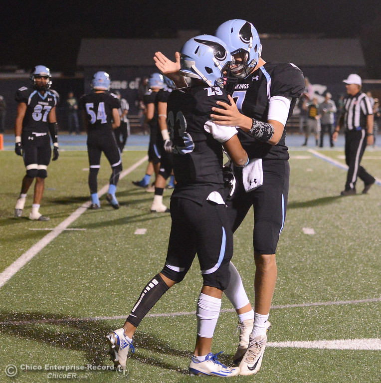 . Pleasant Valley\'s quarterback Tanner Hughes (7) and running back Quiane Rhodes (23) celebrate after the two score the Vikings third touchdown of the night against Paradise High School October 6, 2017 in Chico, California. (Emily Bertolino -- Enterprise-Record)