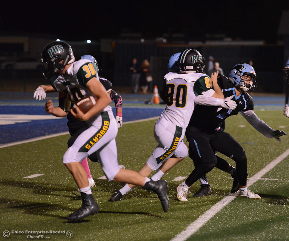 . Paradise\'s Trevor Rickson (30) rushes to the end zone for the Bobcats first touchdown against Pleasant Valley October 6, 2017 in Chico, California. (Emily Bertolino -- Enterprise-Record)