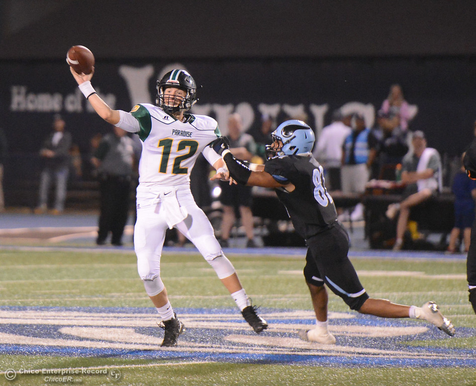 . Paradise\'s quarterback Caden Crumm passes befor Pleasant Valley\'s Iqbal Khan can get to him October 6, 2017 in Chico, California. (Emily Bertolino -- Enterprise-Record)