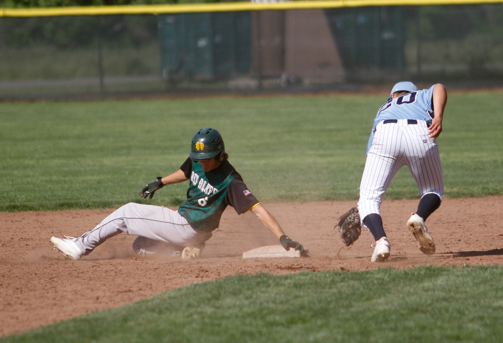 . Red Bluff\'s Eric Spencer touches down safe at second as Pleasant Valley\'s Anthony Montalvo sweeps up the ball as PV hosts Red Bluff in a doubleheader baseball game Tuesday April 18, 2017 at Doryland Field in Chico, California. (Emily Bertolino -- Enterprise-Record)