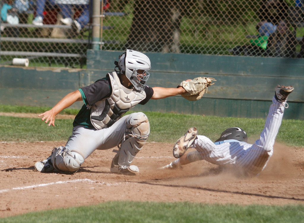 . Red Bluff\'s Tanner Tweedt tags out Pleasant Valley\'s Ryan Busby at home in a doubleheader baseball game Tuesday April 18, 2017 at Doryland Field in Chico, California. (Emily Bertolino -- Enterprise-Record)