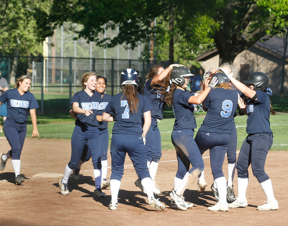 . Pleasant Valley High girls softball team celebrates a 8-7 win over cross town rivals Chico High Thursday April 20, 2017 in Chico, California. (Emily Bertolino -- Enterprise-Record)