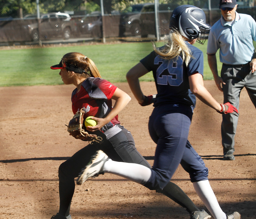 . It was hard getting past Chico\'s first baseman Izzy bishop as she tagged out Pleasant Valley\'s Makenna Pilgrim during a softball game Thursday April 20, 2017 in Chico, California. (Emily Bertolino -- Enterprise-Record)