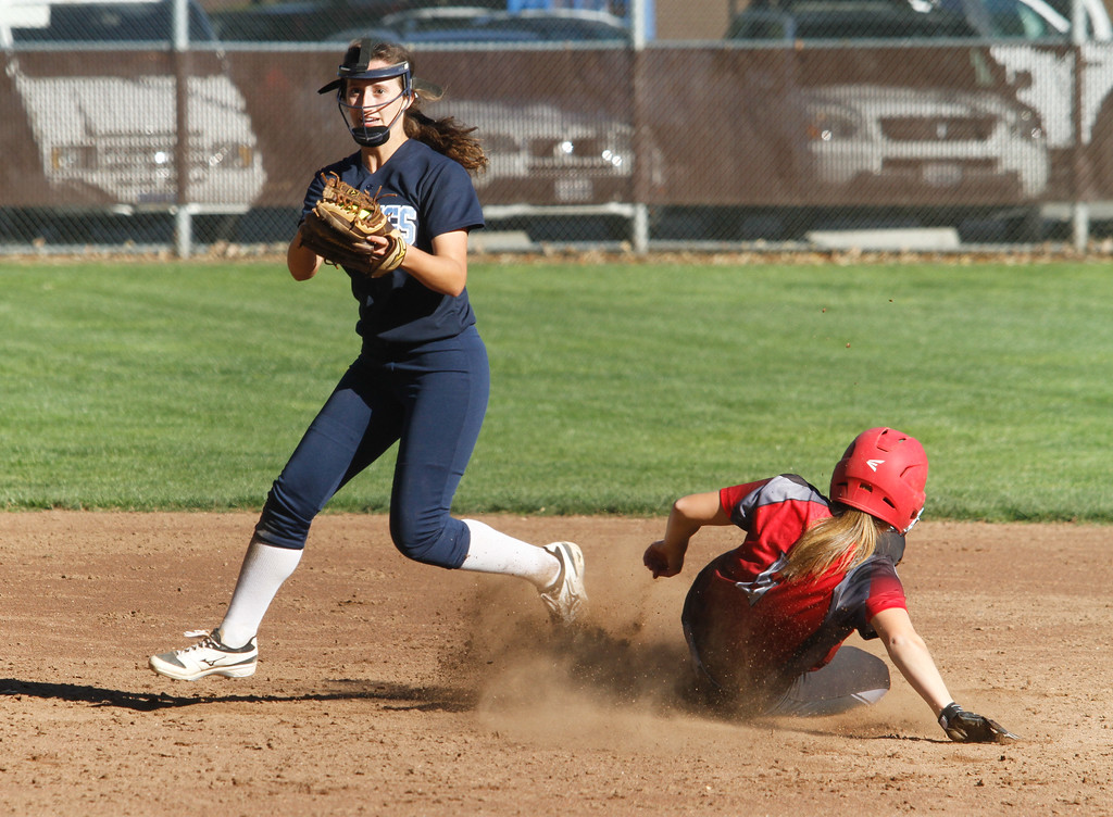 . Pleasant Valley\'s Keeli Bryant picks off Chico\'s Izzy Bishop at second and looks to first during a softball game Thursday April 20, 2017 in Chico, California. (Emily Bertolino -- Enterprise-Record)