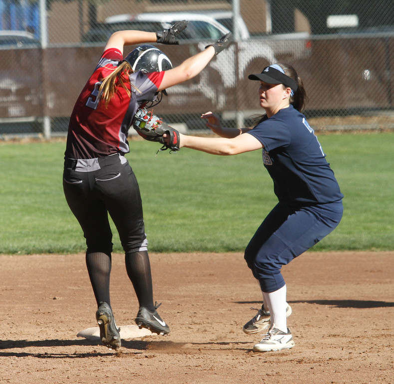 . Pleasant Valley\'s Kamryn Parker tags Chico\'s Caysie Kirby out at second during a softball game Thursday April 20, 2017 in Chico, California. (Emily Bertolino -- Enterprise-Record)