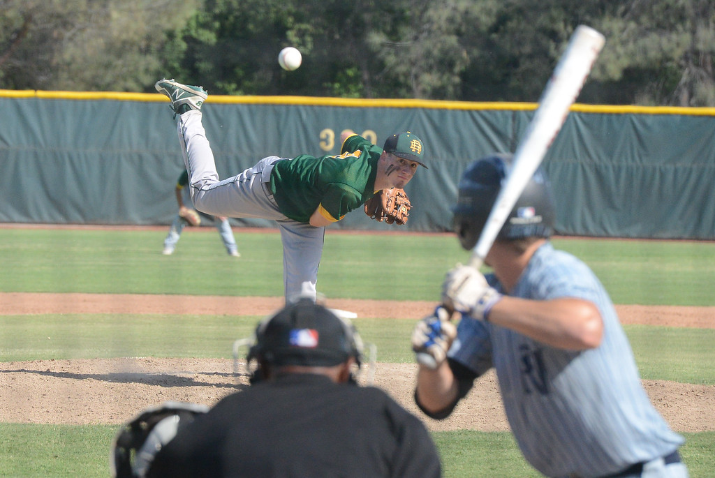 . Red Bluff High\'s Nolan Stacy pitches the ball during the Section Final against Pleasant Valley, May 19, 2018,  in Chico, California. (Carin Dorghalli -- Enterprise-Record)