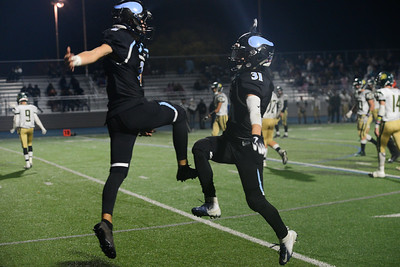 Pleasant Valley's Akia Ramirez and Dalton Walker celebrate Ramirez's touchdown against Red Bluff during the semi final Northern Section Division II football playoff game, Saturday, Nov. 24, 2018, at Asgard Yard in Chico, California. (Carin Dorghalli -- Enterprise-Record)