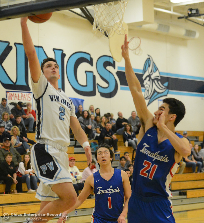 . Pleasant Valley\'s Jarin Polander goes up for a shot over Tamalpais\' Ben Whitaker (21) in the annual McDonald\'s Winter Classic Saturday December 9, 2017 at Pleasant Valley in Chico, California. (Emily Bertolino -- Enterprise-Record)