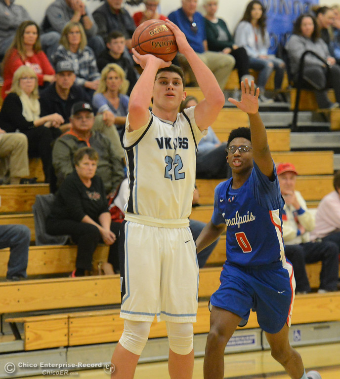 . Pleasant Valley\'s Kevin Kremer goes up for a shot as Tamalpais\' Noah Haynesworth tries to block it in the annual McDonald\'s Winter Classic Saturday December 9, 2017 at Pleasant Valley in Chico, California. (Emily Bertolino -- Enterprise-Record)
