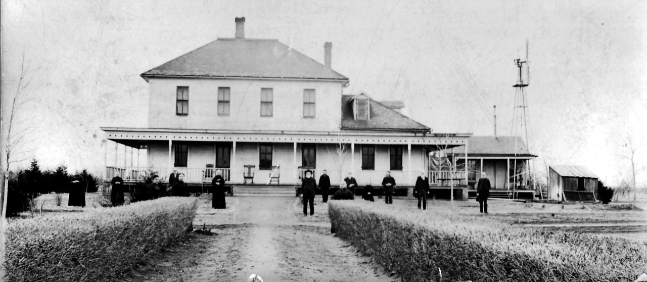 Home in early 1900's with residents out front. The hedge in the foreground leads south about 200 yards to Pleasant View Church.