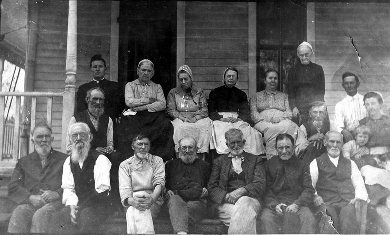 Residents of the Old Folks Home on porch. Unknown date - perhaps 1910 - 1925.
