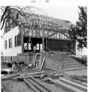 Demolition of Pleasant View Church of the Brethren - late 1960's. Patricia Hornbaker on top of steps next to ladder.