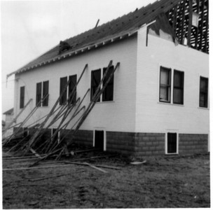 Demolition of Pleasant View Church of the Brethren - late 1960's. Roger Hornbaker on roof.