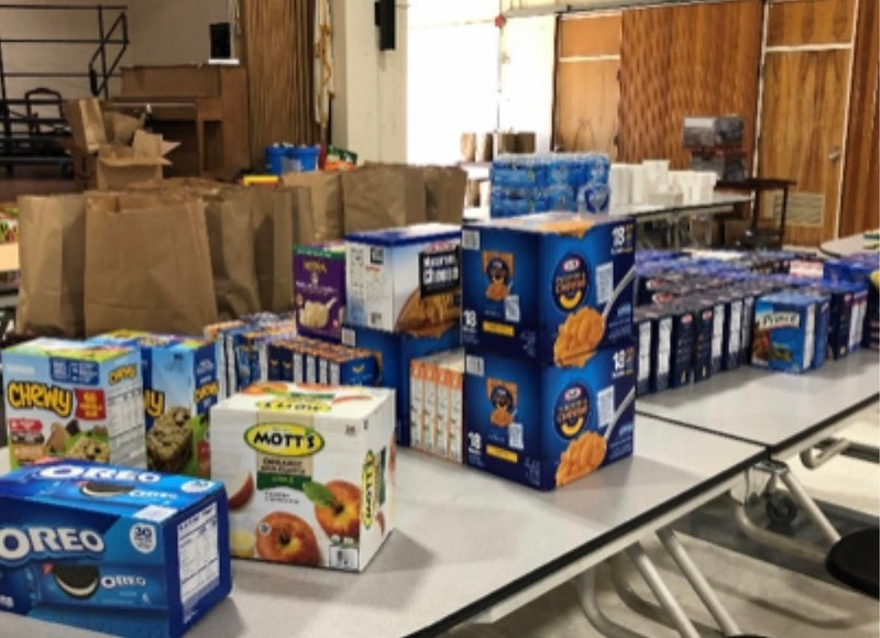 Over the past three months, community members have generously donated food at Harrington Elementary School for needy families.