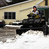 HOLLY PELCZYNSKI - BENNINGTON BANNER Wayne Powers. of Bennington Vermont plows out his driveway, filled with heavy slushy snow, on Monday morning.