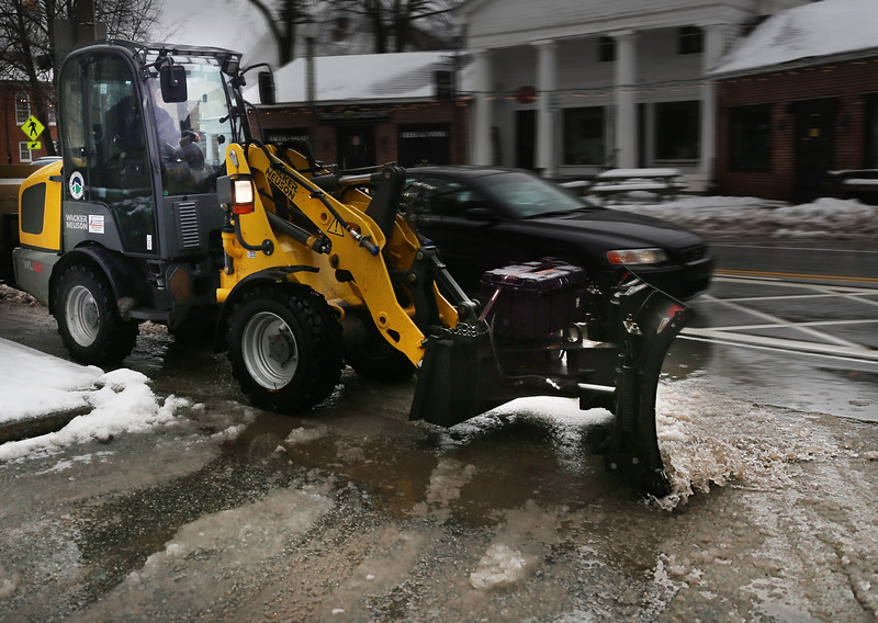 HOLLY PELCZYNSKI - BENNINGTON BANNER A sidewalk plow clears snow and slush from South Street sidewalks on Monday morning after an overnight heavy snowfall and mix of freezing rain.