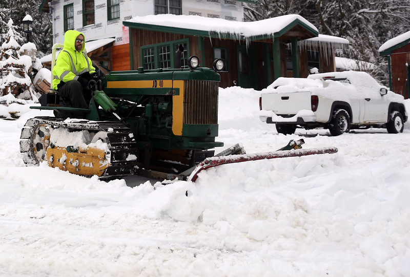 HOLLY PELCZYNSKI - BENNINGTON BANNER Meredith Sirdon of Woodford Vermont plows his driveway in a 1940  John Deer tractor on Monday morning.