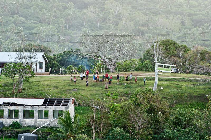Tu'anuku Tonga. Very old Plumeria behind the Tongan locals.