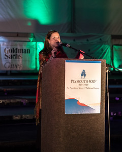 Plymouth 400 Executive Director Michele Pecoraro welcomes a large crowd to the Illuminate ceremony on the waterfront last Saturday night.  Wicked Local Photo/Denise Maccaferri