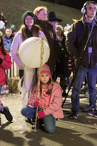 Kristen Lawson, 9, and her Mom Cassandra Hakkila were among the hundreds gathered on the waterfront for the Plymouth 400 Illuminate ceremony on Saturday night.  Wicked Local Photo/Denise Maccaferri