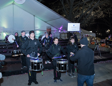 The Plymouth Public Schools Marching Band drum line perform with lighted drumsticks.  Wicked Local Photo/Denise Maccaferri