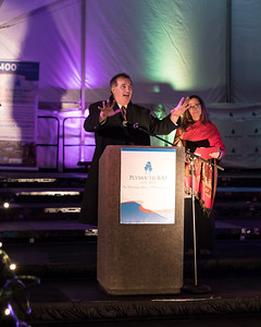 Plymouth Hometown Thanksgiving Celebration Executive Director Olly DeMacedo  rallies the crowd at the Plymouth 400 Illuminate ceremony.  Wicked Local Photo/Denise Maccaferri