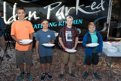 From left, Jay Carpenter, Hunter Sears, Ryan Sears and Adam Carpenter  are all smiles as they reach the Captains & Crew Dinner serving table. Wicked Local Photo/Denise Maccaferri
