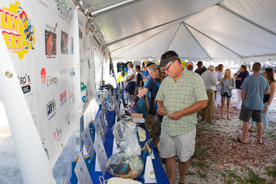 Bass & Blue Captains Dinner guests peruse the multitude of donated raffle items. Wicked Local Photo/Denise Maccaferri