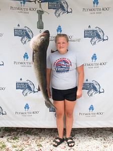 Scarlett O'Farrell poses with the 36.6lb striped bass that won her 1st Place Honors in the Youth Category.  Courtesy Photo/Plymouth 400 Inc.