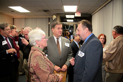 Denis Hanks reminisces with Robbi Haigh and Selectman Mathew Muratore during the PACC Business After Hours event on Thursday.   Hanks is leaving the post he has held for the past 9 years as the Chamber's Executive Director.