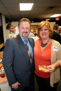 Denis Hanks get a good bye hug from PACC member Claudine Reid of Creative Marketing Results.